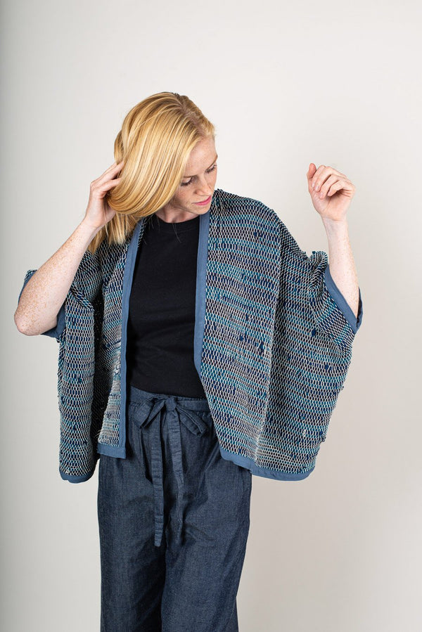 Our ethically made Srey cardigan in peacock.
