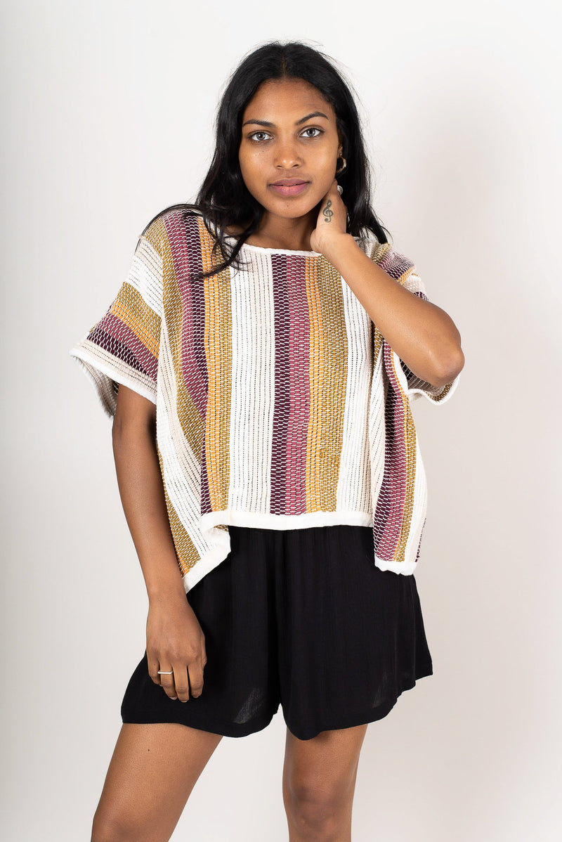 Every Srey crop top we make, like this one in desert stripe, has a unique texture because it is handwoven.