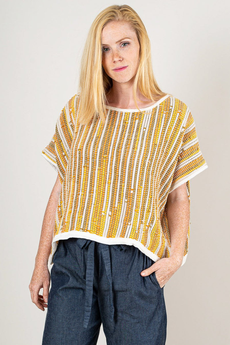Our handwoven, fair fashion Srey crop top is seen here in marigold.