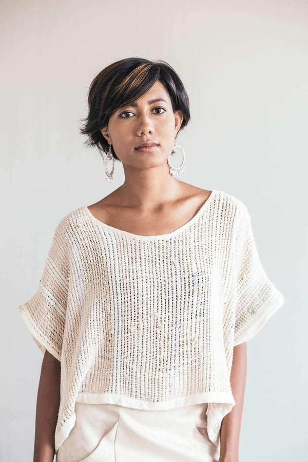 Our Srey crop top, seen here in natural, is handwoven from reclaimed yarns in our unique zero waste process.