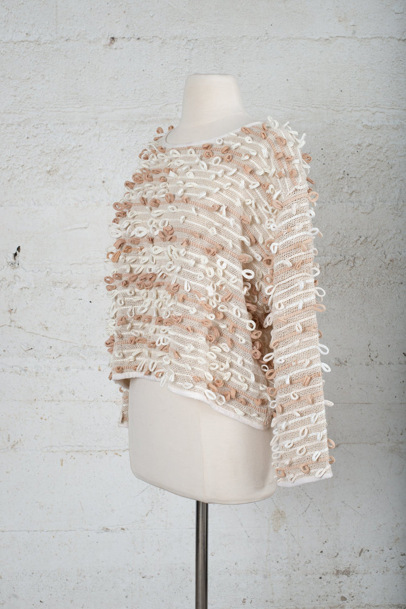 Front, angle view of a sustainable fashion secondhand garment.