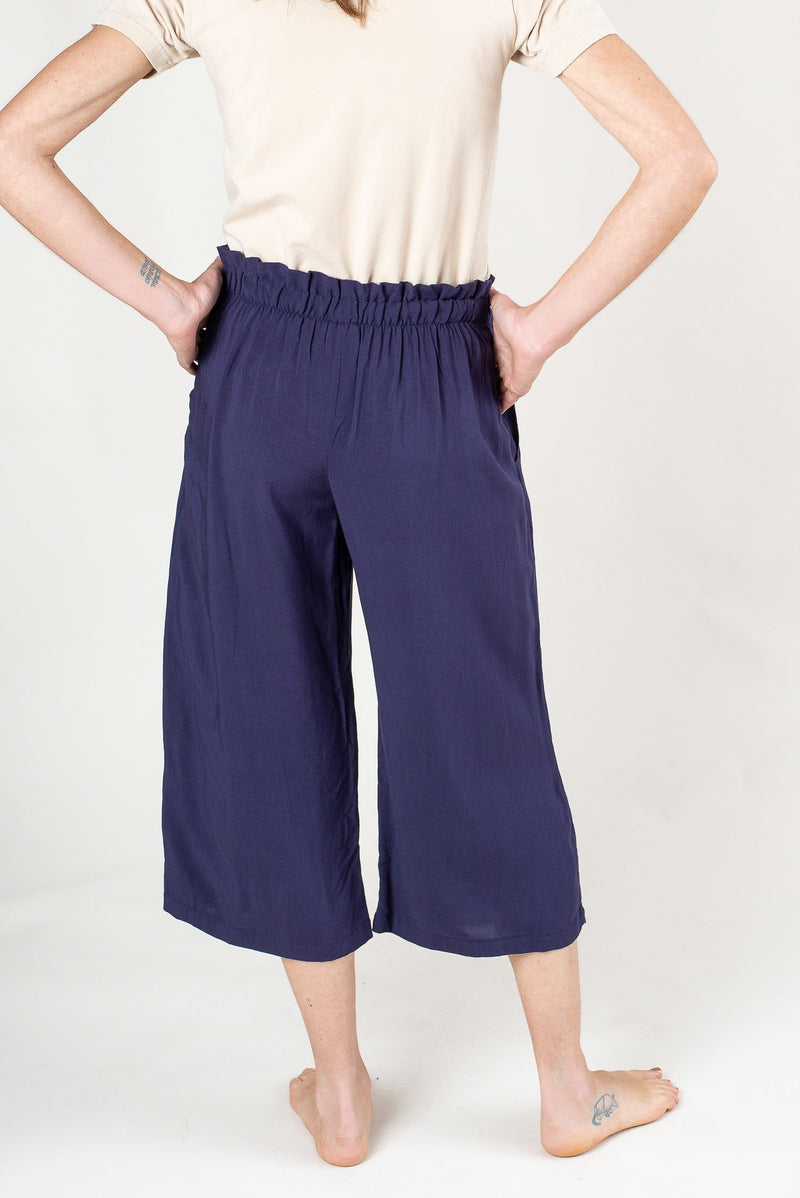 A back view of our sustainably made Srey Pov culottes that shows a detail of the side pockets.