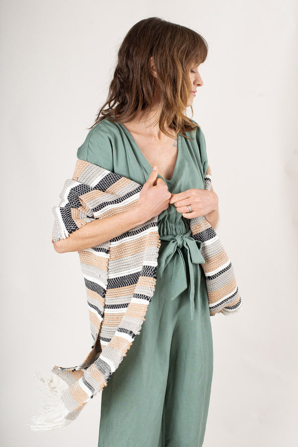 The sustainably made Srey scarf is wide enough to be worn as a wrap over elegant ensembles.