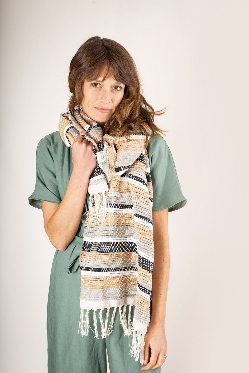 The Srey scarf, shown here in our canyon color, will keep you cozy in cold weather