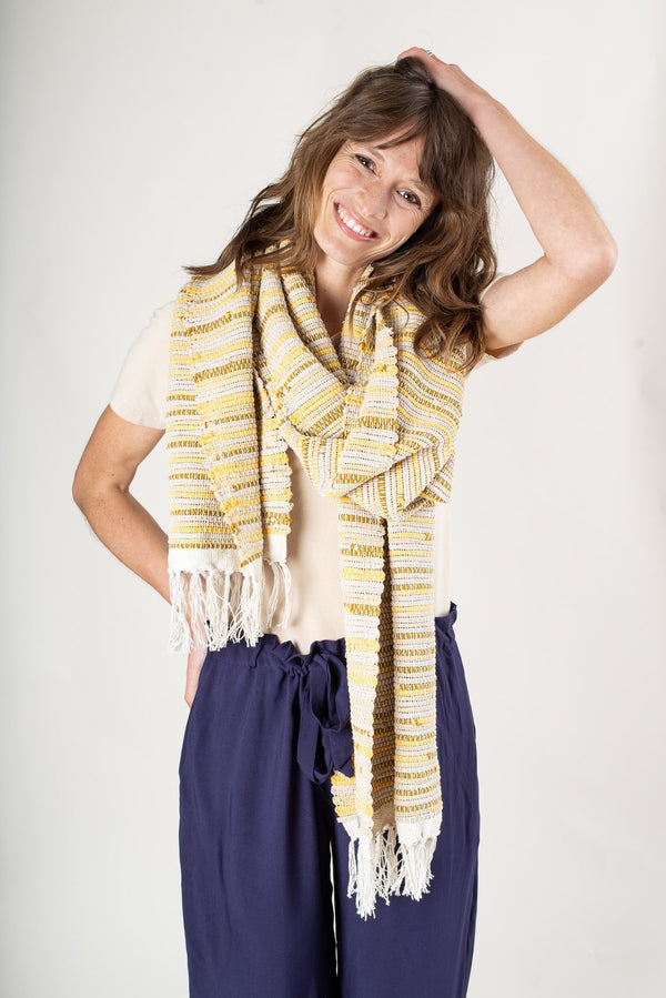 Our handwoven Srey scarf adds color and texture to any look. Made ethically in a zero waste process.