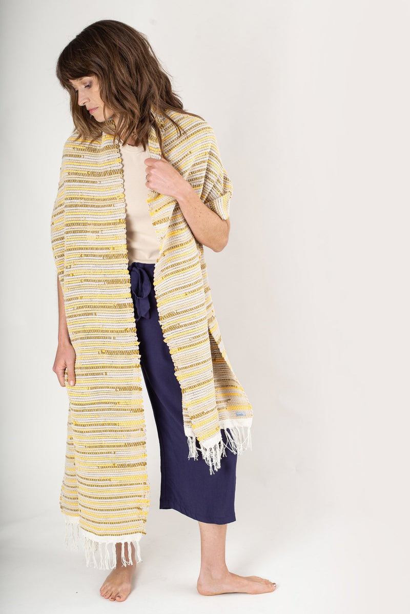 You can see the full length of the Srey scarf here, shown is our marigold color.