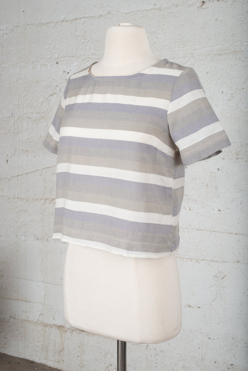 Front, angle view of a sustainable fashion secondhand top.