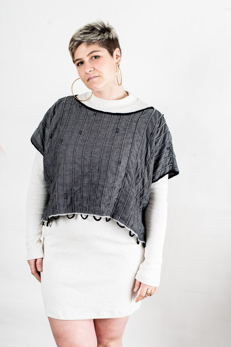 The ethically made Takeo crop top, seen here in charcoal, also works well as a layering piece to go over sweaters or dresses.