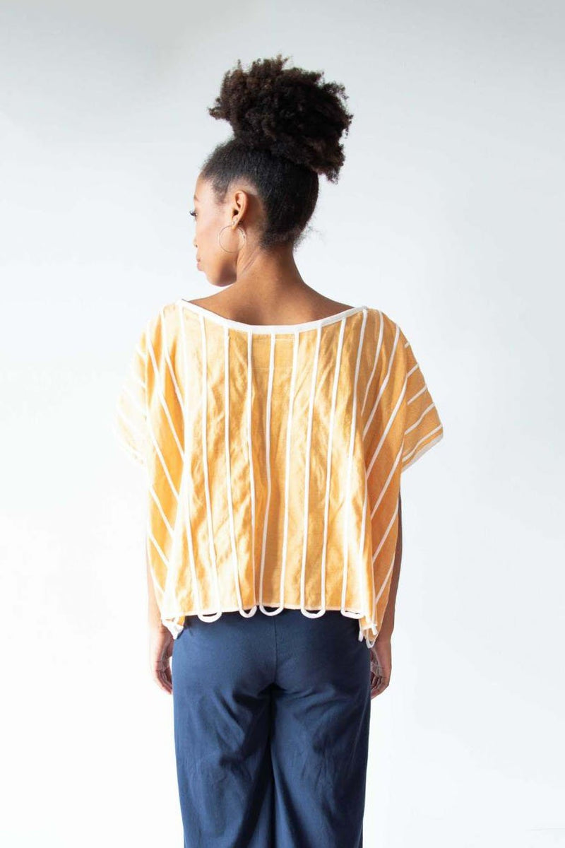 A back view of the ethically made Takeo crop top that shows the all over knit design.