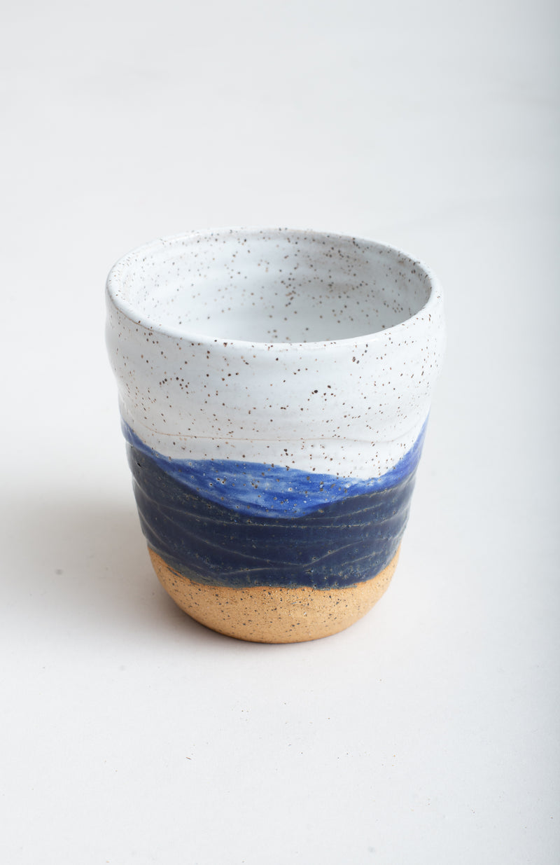 This detail shot shows the handmade texture of the mug at the base.