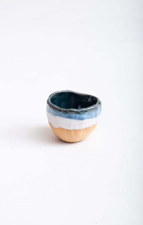 This handmade ceramic bowl can serve hot or cold dishes.