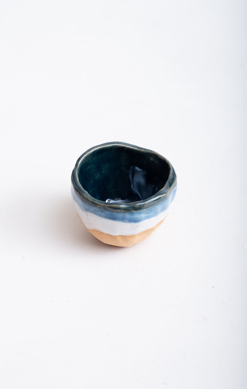 A view of the interior and exterior glaze on this handmade ceramic bowl.