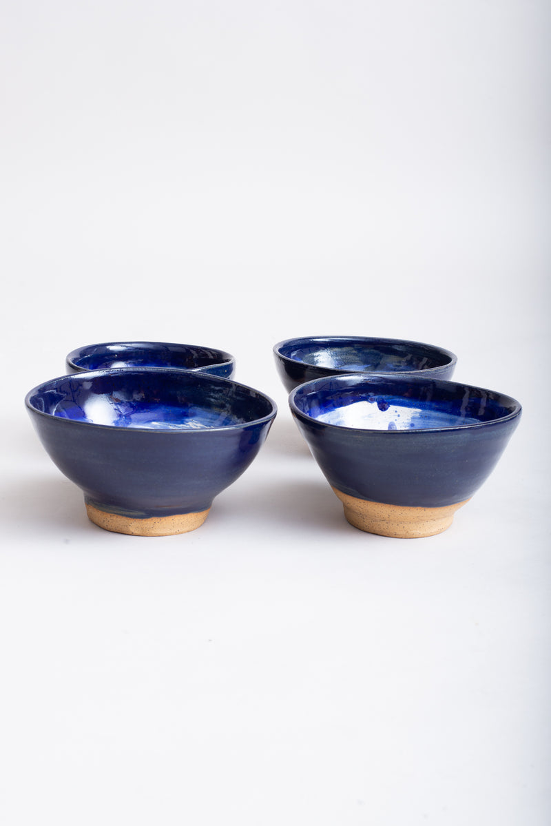 This image shows the slight variations in shape of the bowls, highlighting their handmade nature.
