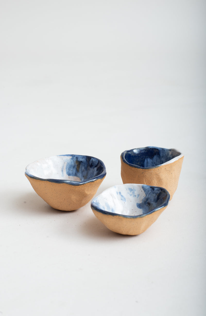 A view of these handmade ceramic pinch bowls that shows the sizes in relation to one another.