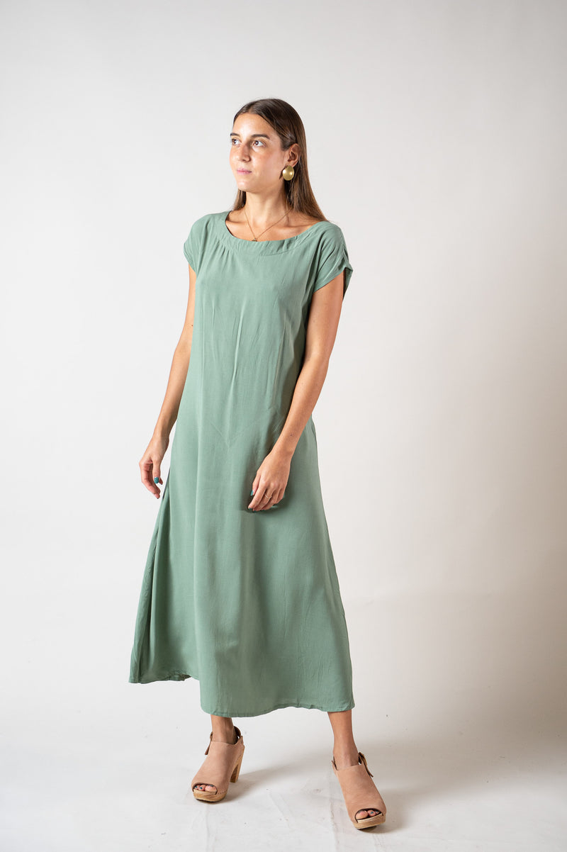 The waist tie on our ethically made Sofia dress can be tied in back, as seen here, or in the front.