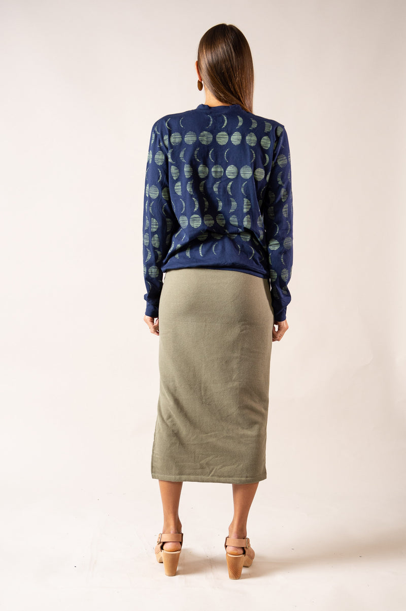 A back view of our ethical fashion Sokha top in navy with an allover moon cycle print.