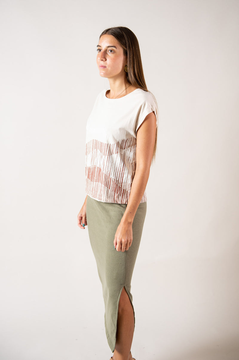 A side view of our circular fashion Keang top with a mountain range print in khaki.