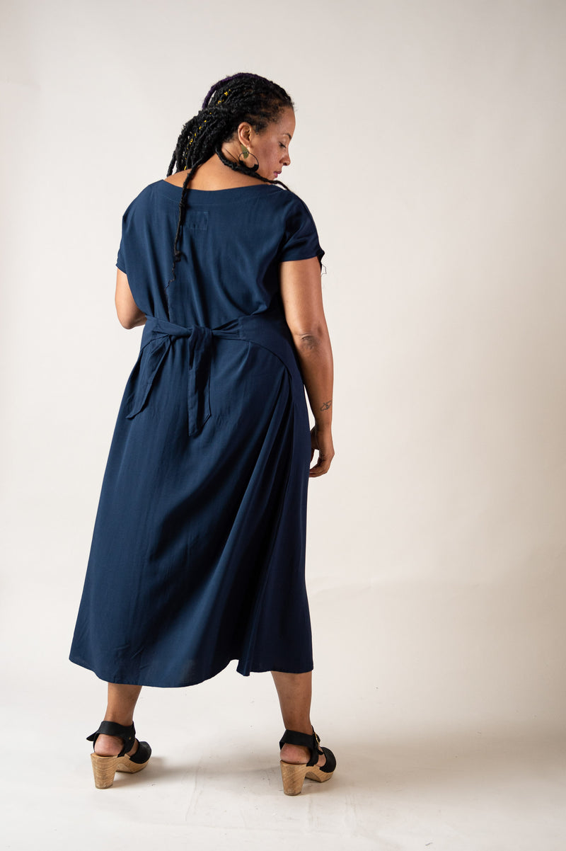 This back view of our Sofia dress shows the length of the hem and a detail of the waist tie.