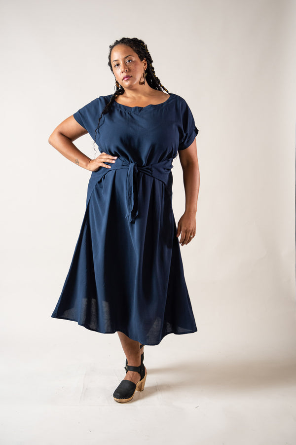 The Sofia dress, seen here in navy, is made from reclaimed rayon in our zero waste process.