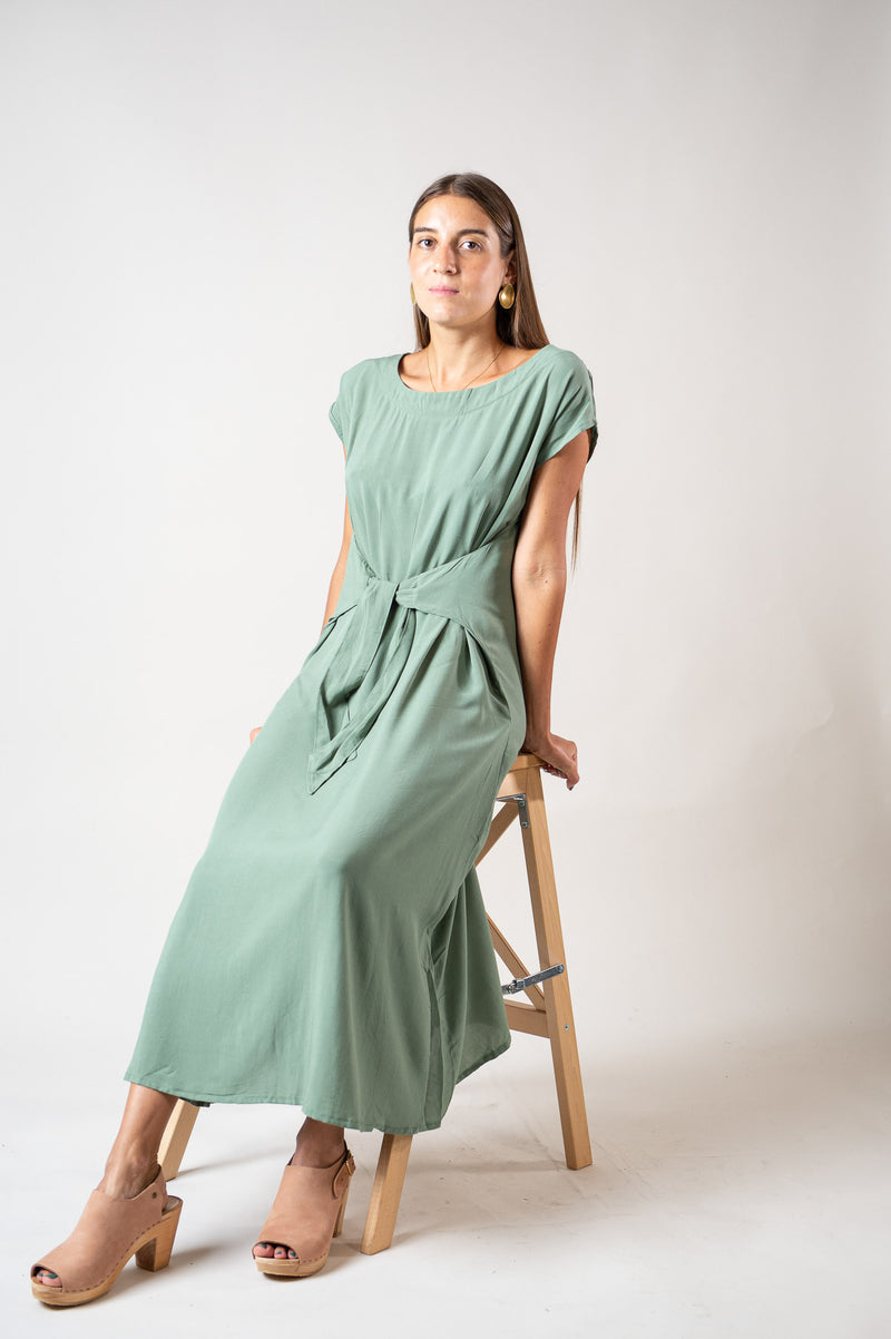 Our Sofia dress, seen here in sage, is a must for any minimalist capsule wardrobe.