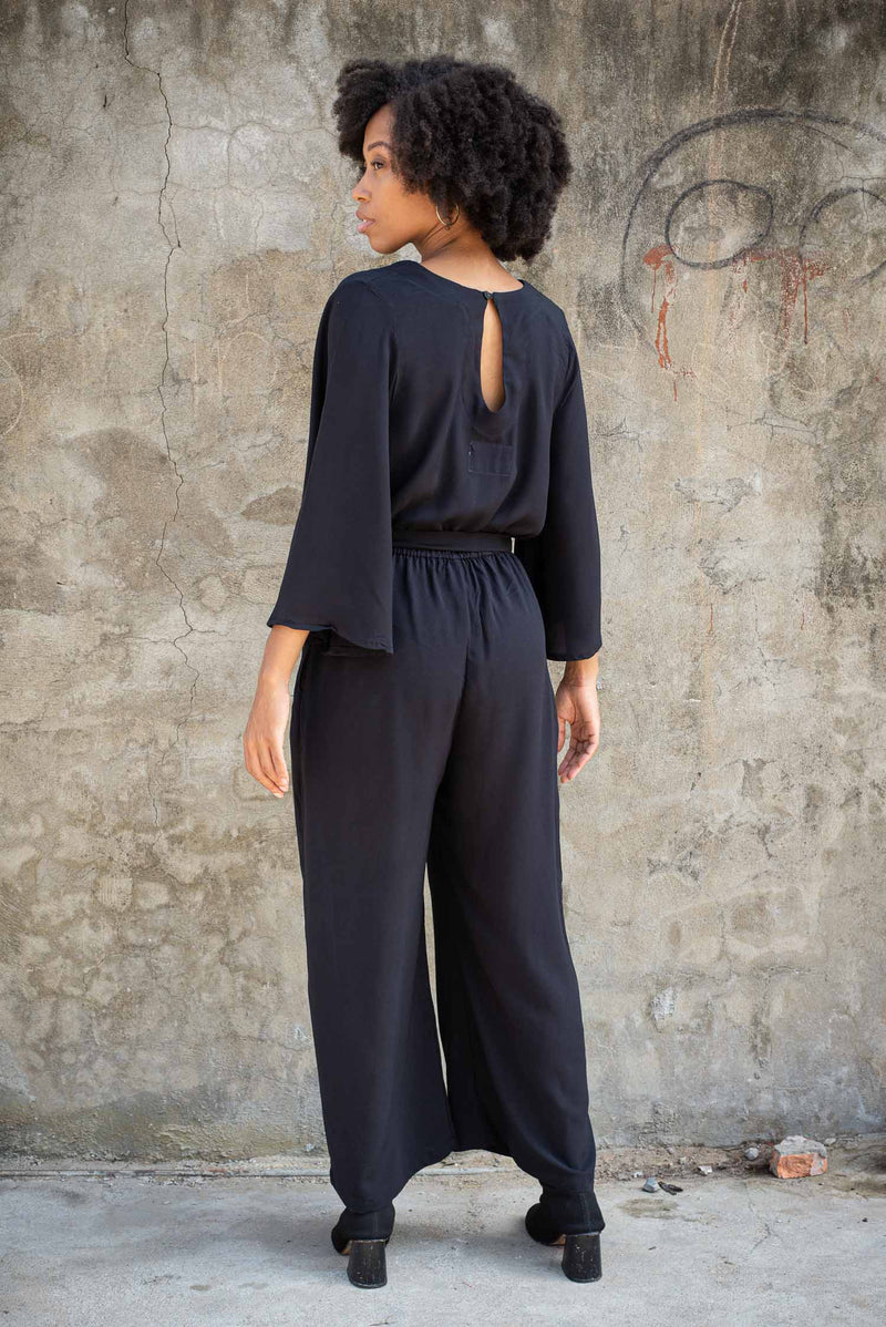 A back view of the Vanna jumpsuit that shows the button closure at the back of the keyhole neck.