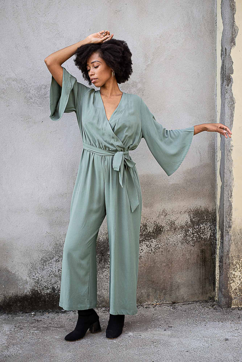 Our ethical fashion Vanna jumpsuit in sage. This photo shows the wide cut of the sleeves.