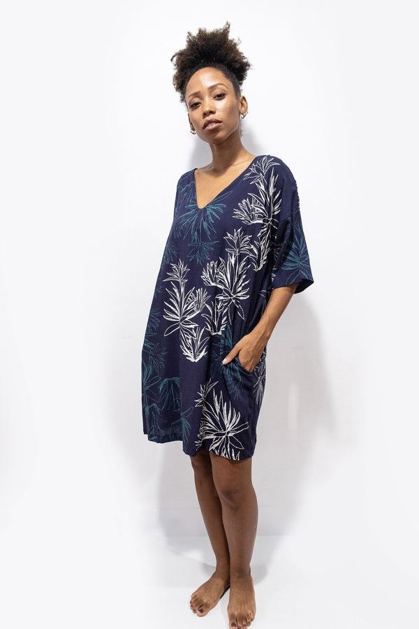 The Veha dress, seen here in navy with a cactus print, is made from reclaimed rayon as part of our unique zero waste process.