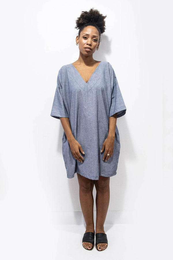 Our ethically made Veha dress can be styled casually with minimal accessories, as seen here in chambray.