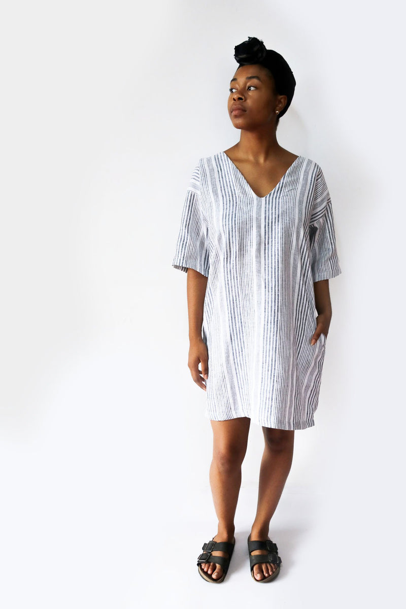 Our ethically made Veha dress, seen here in striped linen, is a breezy go-to in warm weather.
