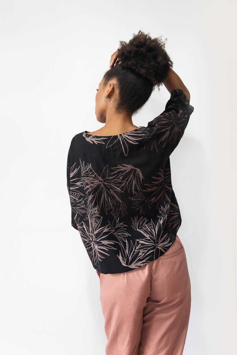 A back view of the Veha top in black with our cactus print that shows the airy cut.