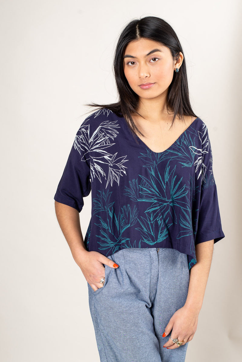 A front view of our ethically made Veha top in navy with a cactus print.