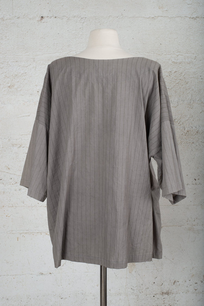 Back view of a pre-worn top for sale on our circular fashion trade-in, consignment-like platform.