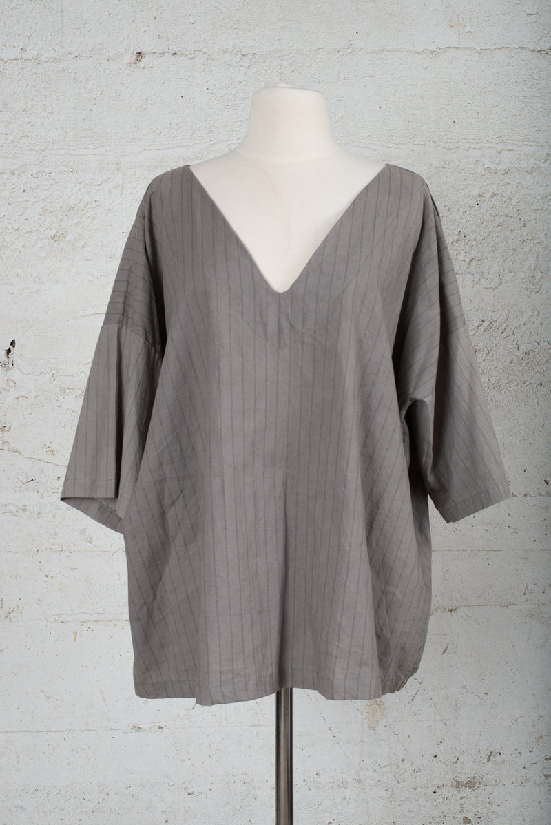 Front view of a circular fashion resale top, made from reclaimed cotton jersey in our zero waste process.