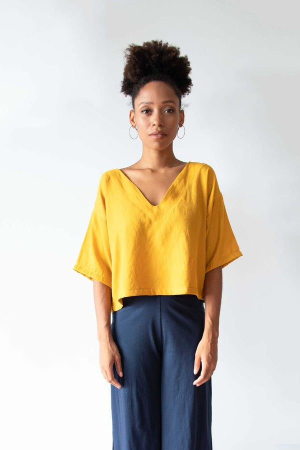 The Veha top is made from reclaimed textiles in our unique zero waste process. Seen here in marigold.