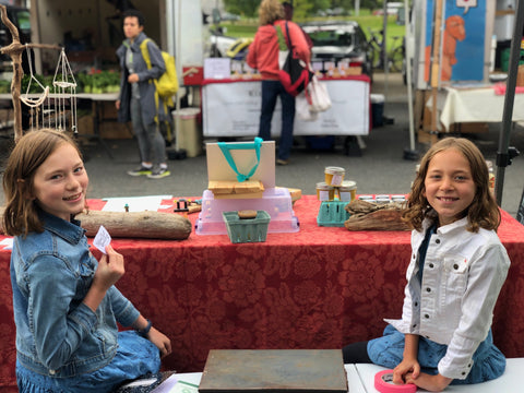 Two GabGirls selling their products at the Yarmouth Farmer's Market after completing the incubating innovators program