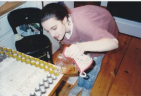 Gab making her natural lip balm in her mom's kitchen in 1991