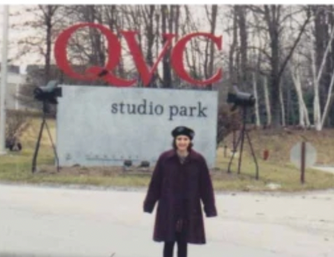 Mad Gab's founder, Gabrielle Melchionda, standing in front on the QVC studio park sign.