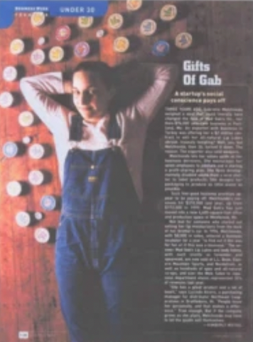 A scan of a Business Week magazine page featuring an article discussing Mad Gab's products with a photo of Gab laying on the floor with lip and body balm tins surrounding her.