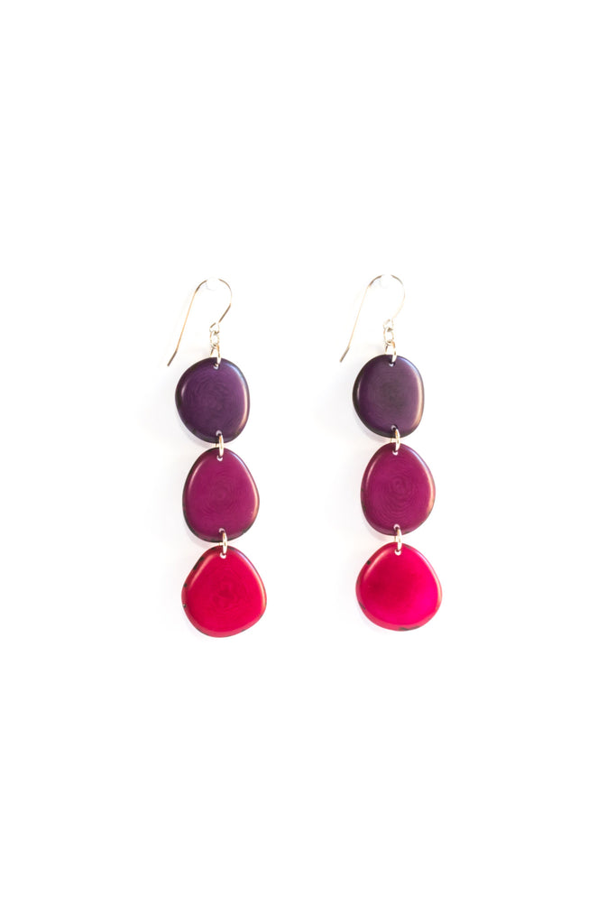 Aurora earrings plum are sustainably made fair trade red earrings made of polished tagua seed from South American rainforests.