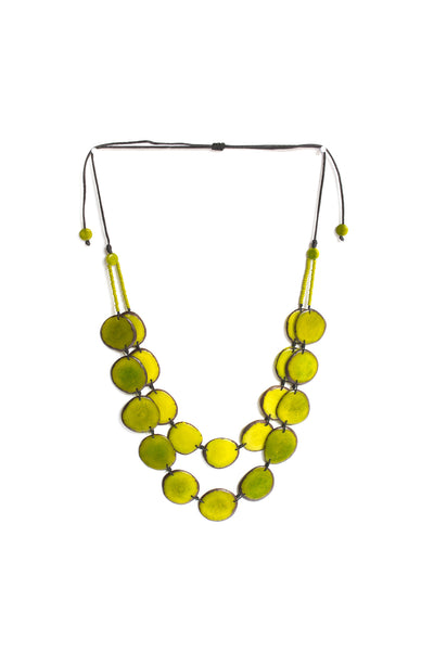 Aurora necklace bamboo is sustainably made fair trade necklace made of silk cord and polished tagua seed.