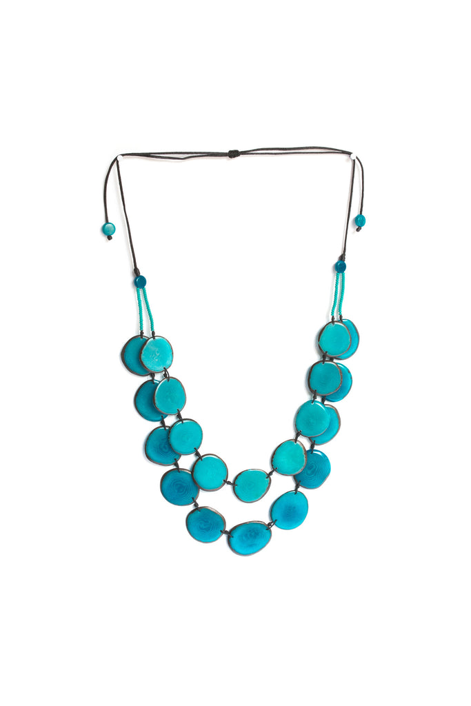 Aurora necklace blue sea is sustainably made fair trade necklace made of silk cord and polished tagua seed.