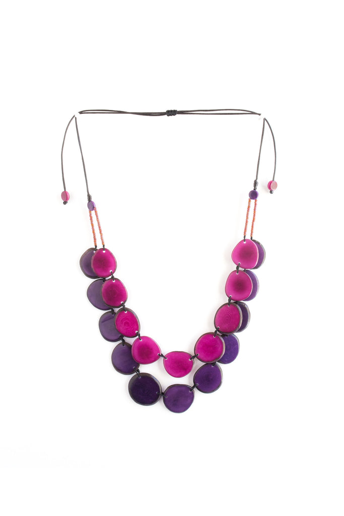 Aurora necklace plum is sustainably made fair trade necklace made of silk cord and polished tagua seed.