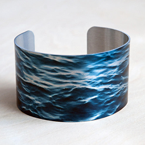Aluminum print cuff deep blue sea is American made and is scratch resistant, smooth, comfortable and highly flexible cuff that fits most wrists.