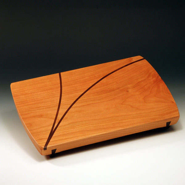 Large wood serving board by Thomas Work is an artisan handmade cherry wood serving and cutting board with decorative accents, handcrafted in the U.S.A..  Makes a great hostess or housewarming gift.