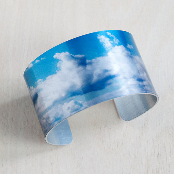 Aluminum print cuff clouds is American made and is scratch resistant, smooth, comfortable and highly flexible cuff that fits most wrists.