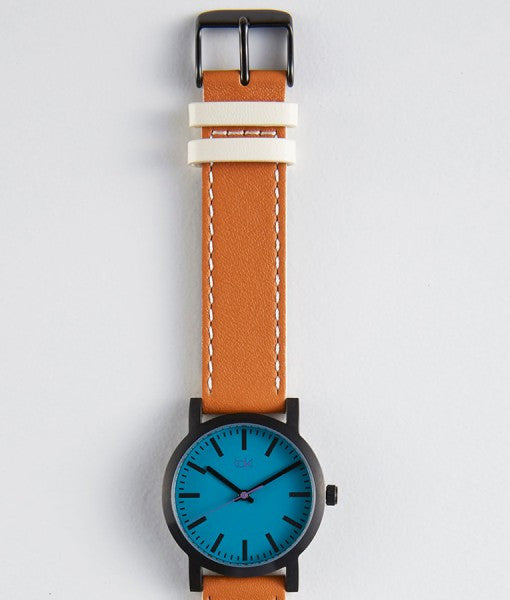 Nicolette teal saddle watch clean, simple classically designed with teal face and saddle brown band.