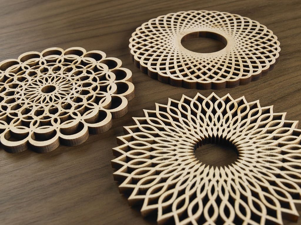 Five Ply Design set of 3 laser cut trivets Spiral Series Close Up