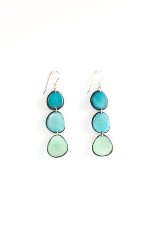 Aurora earrings aqua are sustainably made fair trade blue-green earrings made of polished tagua seed from South American rainforests.