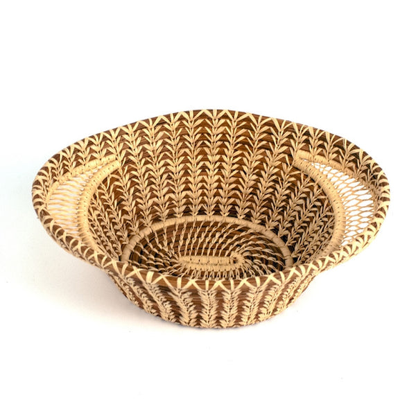 Lacy handle basket is a fair trade delicately handwoven basket made of pine needles and raffia created and designed by the women of Mayan Hands El Triunfo cooperative.