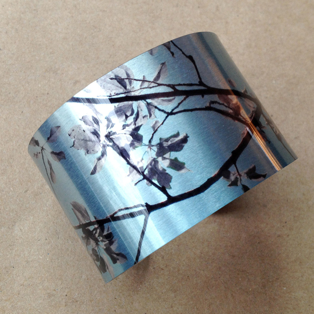 Aluminum print cuff orchard is American made and is scratch resistant, smooth, comfortable and highly flexible cuff that fits most wrists.